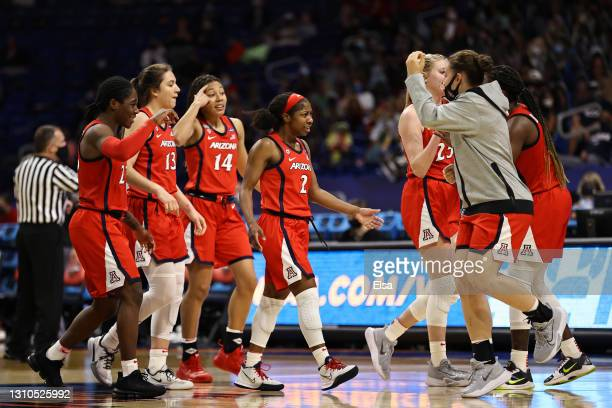 Arizona Wildcats celebrate after the third quarter against the UConn Huskies in the Final Four semifinal game of the 2021 NCAA Women's Basketball...