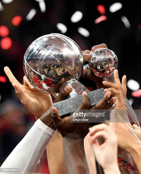 Arizona Wildcats celebrate with the championship trophy and Deandre Ayton's Most Outstanding Player trophy after defeating the USC Trojans 7561 to...