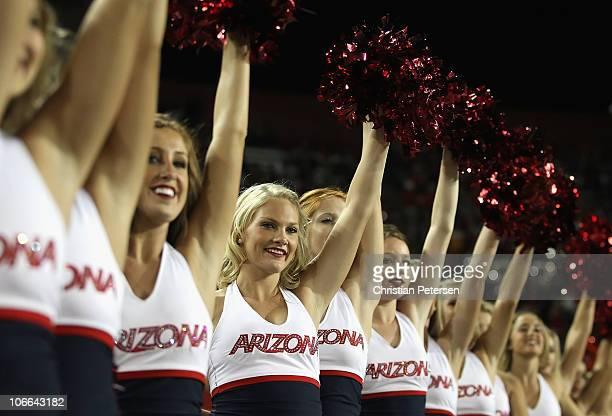 Arizona Wildcats cheerleaders peform during the college football game against the Washington Huskies at Arizona Stadium on October 23 2010 in Tucson...