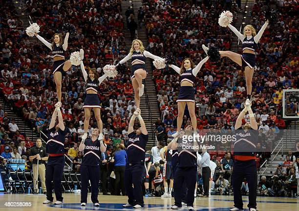 Arizona Wildcats cheerleaders perform against the Gonzaga Bulldogs during the third round of the 2014 NCAA Men's Basketball Tournament at Viejas...