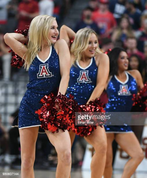 Arizona Wildcats cheerleaders perform during the championship game of the Pac12 basketball tournament between the Wildcats and the USC Trojans at...