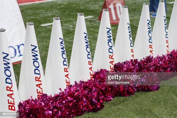 Arizona Wildcats cheerleader's poms and megaphones during a college football game between the UCLA Bruins and Arizona Wildcats on October 14 at...