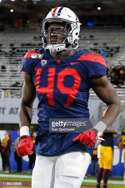 Arizona Wildcats defensive end Jalen Harris jogs onto the field before the college football game between the Arizona Wildcats and the Arizona State...