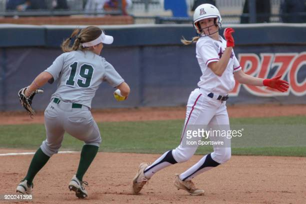 Arizona Wildcats dp Jenna Kean tries to avoid the tag from Colorado State Rams infielder Sarah Muzik during a run down during the a college softball...