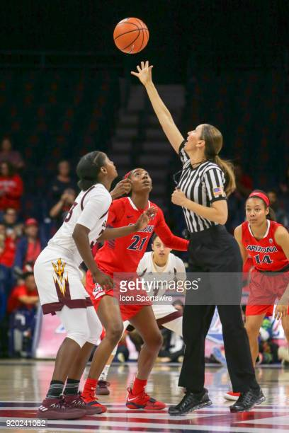 Arizona Wildcats forward Destiny Graham and Arizona State Sun Devils center Charnea JohnsonChapman prepare to jump to get the tip off during the a...