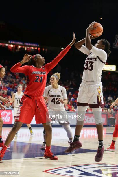 Arizona Wildcats forward Destiny Graham tries to block Arizona State Sun Devils center Charnea JohnsonChapman shot during the a college women's...