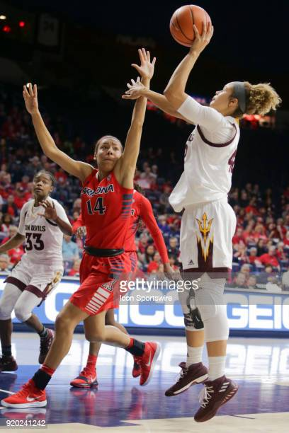 Arizona Wildcats forward Sam Thomas tries to block Arizona State Sun Devils forward Kianna Ibis shot during the a college women's basketball game...