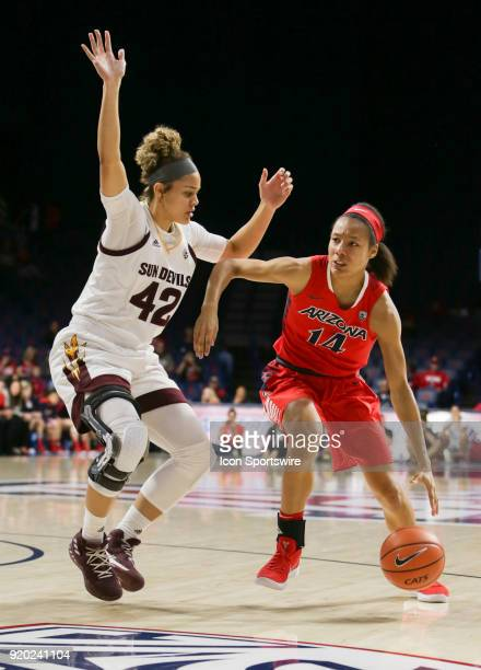 Arizona Wildcats forward Sam Thomas tries to dribble around Arizona State Sun Devils forward Kianna Ibis during the a college women's basketball game...
