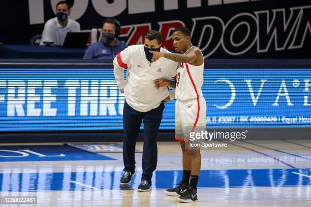 Arizona Wildcats guard James Akinjo talks with Arizona Wildcats head coach Sean Miller during a college basketball game between the Northern Arizona...