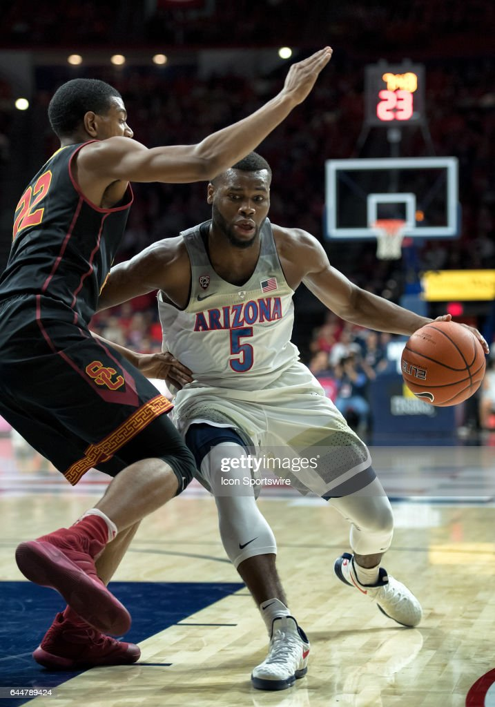 Arizona Wildcats guard Kadeem Allen (5) drives through USC Trojans guard De'Anthony Melton (22) during the college basketball game between the Arizona Wildcats and the USC Trojans on February 23, 2017, at McKale Center in Tucson, Arizona.