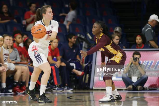 Arizona Wildcats guard Lucia Alonso tries to past the ball past Iona Gaels guard Toyosi Abiola during the a college women's basketball game between...