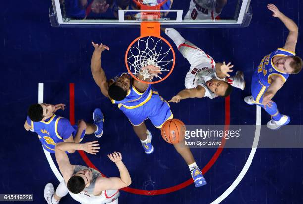 Arizona Wildcats guard Parker JacksonCartwright shoots over UCLA Bruins forward Ike Anigbogu and guard Bryce Alford during the first half of the...