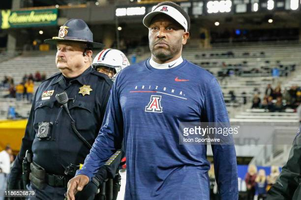 Arizona Wildcats head coach Kevin Sumlin walks onto the field before the college football game between the Arizona Wildcats and the Arizona State Sun...