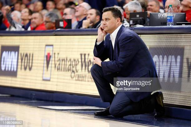 Arizona Wildcats head coach Sean Miller watches the action during the second half of the college basketball game against the USC Trojans at McKale...
