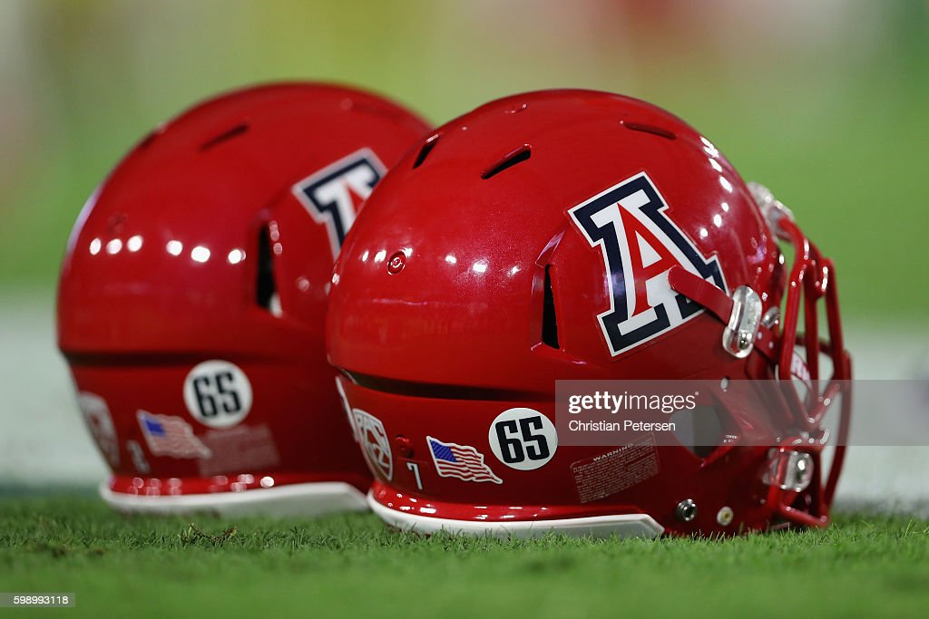 Arizona Wildcats helmets display the #65 to honor offensive lineman Zach Hemmila who passed away in the off-season before the college football game against the Brigham Young Cougars at University of Phoenix Stadium on September 3, 2016 in Glendale, Arizona.