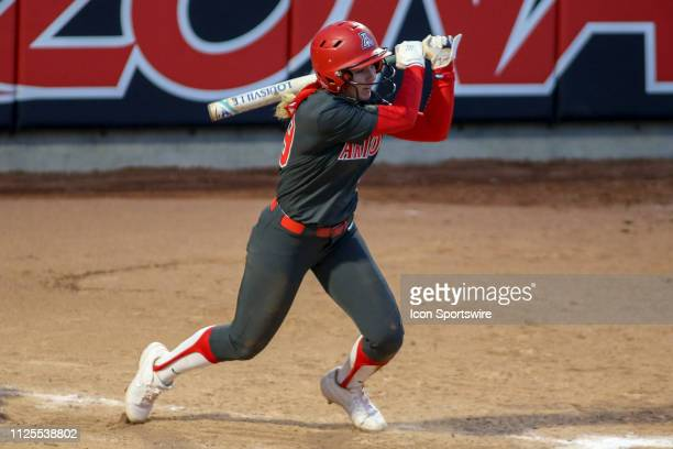 Arizona Wildcats infielder Jessie Harper swings through the hit during a college softball game between the Alabama Crimson Tide and the Arizona...