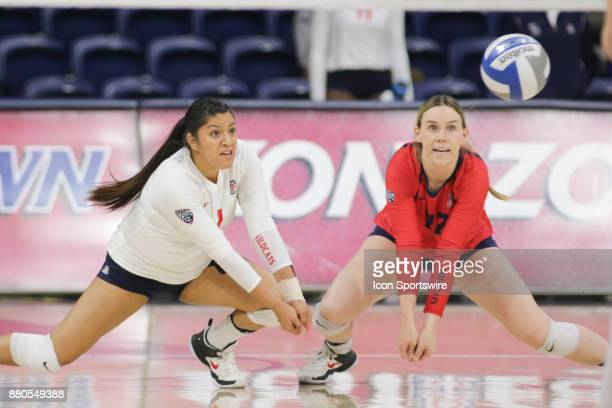 Arizona Wildcats libero/defensive specialist Kimberly Gutierrez and Arizona Wildcats defensive specialist Makenna Martin try to hit the ball during...