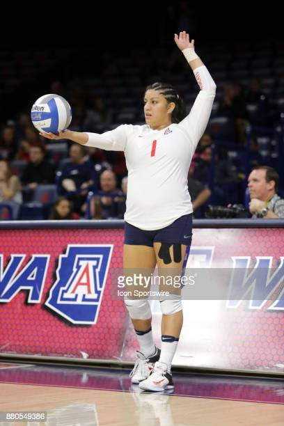 Arizona Wildcats libero/defensive specialist Kimberly Gutierrez set up to serve the ball during the a college volleyball game between Arizona State...
