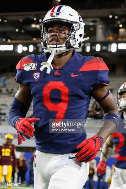 Arizona Wildcats linebacker DayDay Coleman jogs onto the field before the college football game between the Arizona Wildcats and the Arizona State...