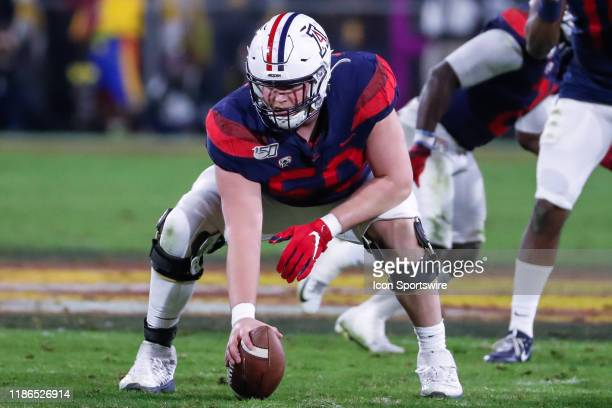Arizona Wildcats offensive lineman Josh McCauley sets up for the play during the college football game between the Arizona Wildcats and the Arizona...