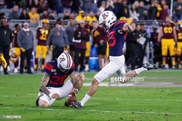 Arizona Wildcats place kicker Lucas Havrisik kicks an extra point during the college football game between the Arizona Wildcats and the Arizona State...