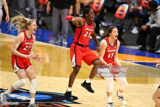 Arizona Wildcats players celebrate their win over the Connecticut Huskies in the semifinals of the NCAA Women's Basketball Tournament at Alamodome on...
