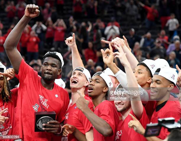 Arizona Wildcats players including Deandre Ayton celebrate after defeating the USC Trojans 7561 to win the championship game of the Pac12 basketball...