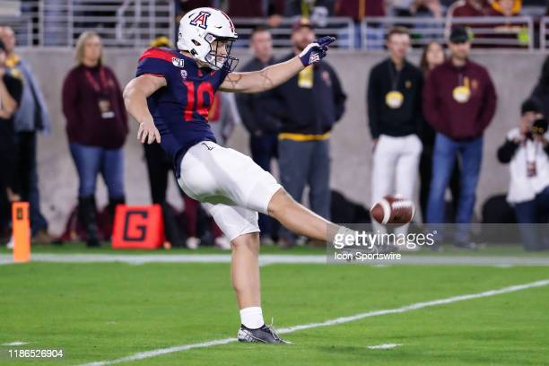 Arizona Wildcats punter Kyle Ostendorp punts the ball during the college football game between the Arizona Wildcats and the Arizona State Sun Devils...