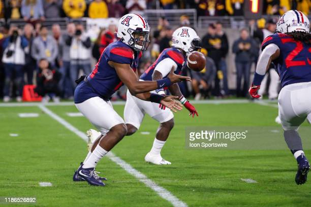 Arizona Wildcats quarterback Khalil Tate pitches the ball forward to Arizona Wildcats running back Gary Brightwell during the college football game...
