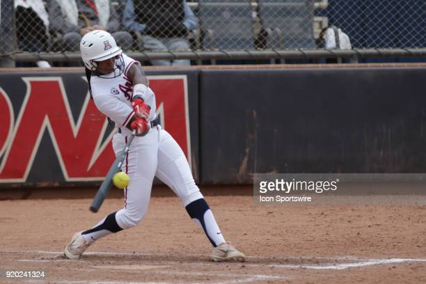 Arizona Wildcats right fielder Aleah Craighton hits the ball during the a college softball game between Colorado State Rams and the Arizona Wildcats...