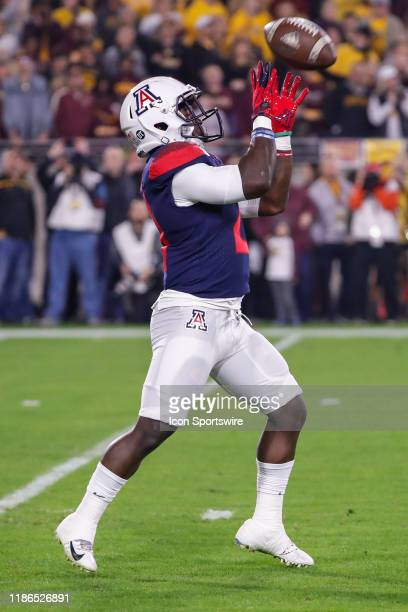 Arizona Wildcats running back JJ Taylor receives a kick during the college football game between the Arizona Wildcats and the Arizona State Sun...
