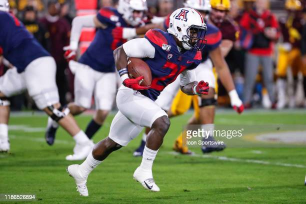 Arizona Wildcats running back JJ Taylor runs the ball during the college football game between the Arizona Wildcats and the Arizona State Sun Devils...