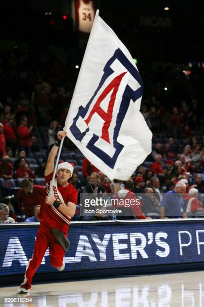 Arizona Wildcats runs onto the court with a flag during the a college basketball game between Connecticut Huskies and Arizona Wildcats on December 21...