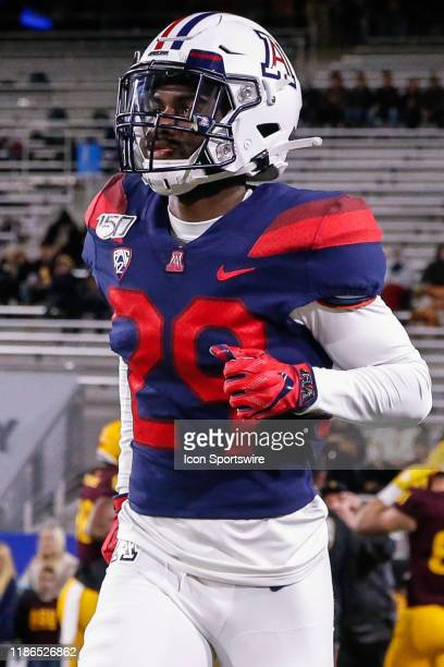 Arizona Wildcats safety Samari Springs jogs onto the field before the college football game between the Arizona Wildcats and the Arizona State Sun...