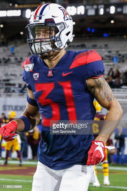 Arizona Wildcats safety Tristan Cooper jogs onto the field before the college football game between the Arizona Wildcats and the Arizona State Sun...