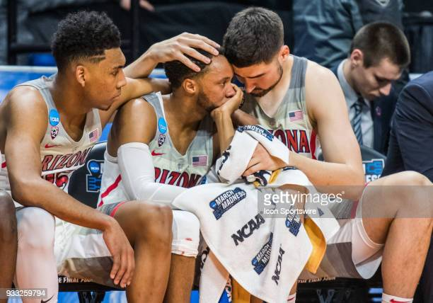 Arizona Wildcats teammates console each other in the last minutes of the first round playoffs between the Arizona Wildcats and the Buffalo Bulls on...