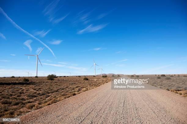 USA, Arizona, Wind turbines and road in arid landscape