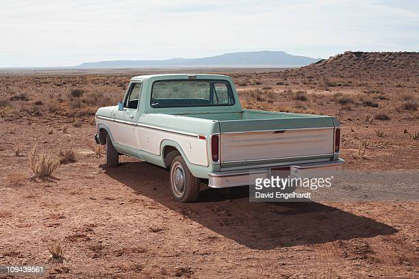 usa, arizona, winslow, pick-up truck on desert - abandoned car stock photos and pictures