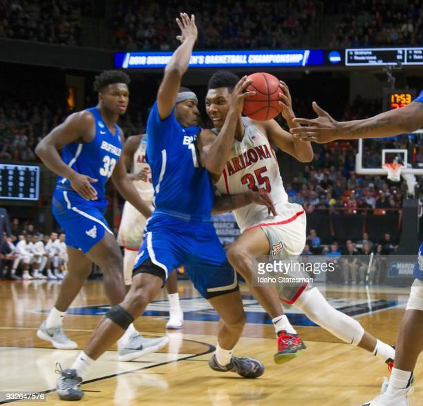 Arizona's Allonzo Trier drives into Buffalo's Montell McRae in the first round of the NCAA Tournament's West Regional on Thursday March 15 at Taco...