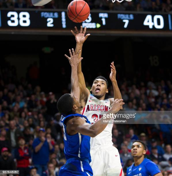 Arizona's Allonzo Trier pulls up for a jumper over Buffalo's CJ Massinburg in the first round of the NCAA Tournament's West Regional on Thursday...