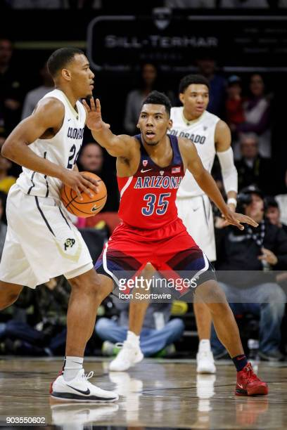 Arizona's Alonzo Trier plays defense against Colorado's George King during their regular season PAC12 basketball game on January 06 2018 at the Coors...