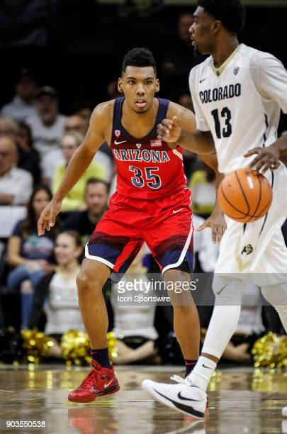 Arizona's Alonzo Trier plays defense against Colorado's Namon Wright during their regular season PAC12 basketball game on January 06 2018 at the...