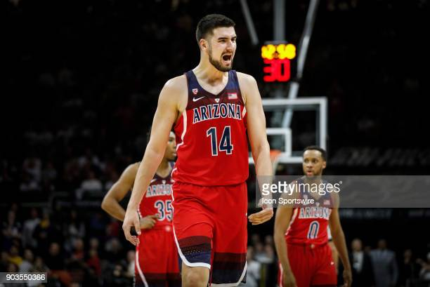 Arizona's Dusan Ristic tries to fire up his teammates as he walks off the court against Colorado during their regular season PAC12 basketball game on...