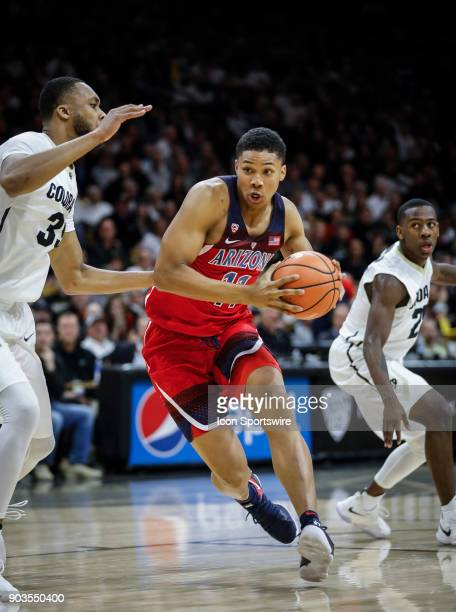 Arizona's Ira Lee drives the lane in front of Colorado's Dallas Walton during their regular season PAC12 basketball game on January 06 2018 at the...
