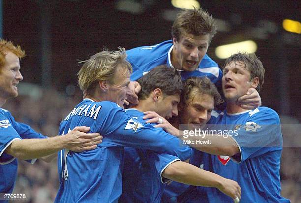 Arjan De Zeeuw of Portsmouth celebrates scoring their first goal during the FA Barclaycard Premiership match between Portsmouth and Leeds United at...