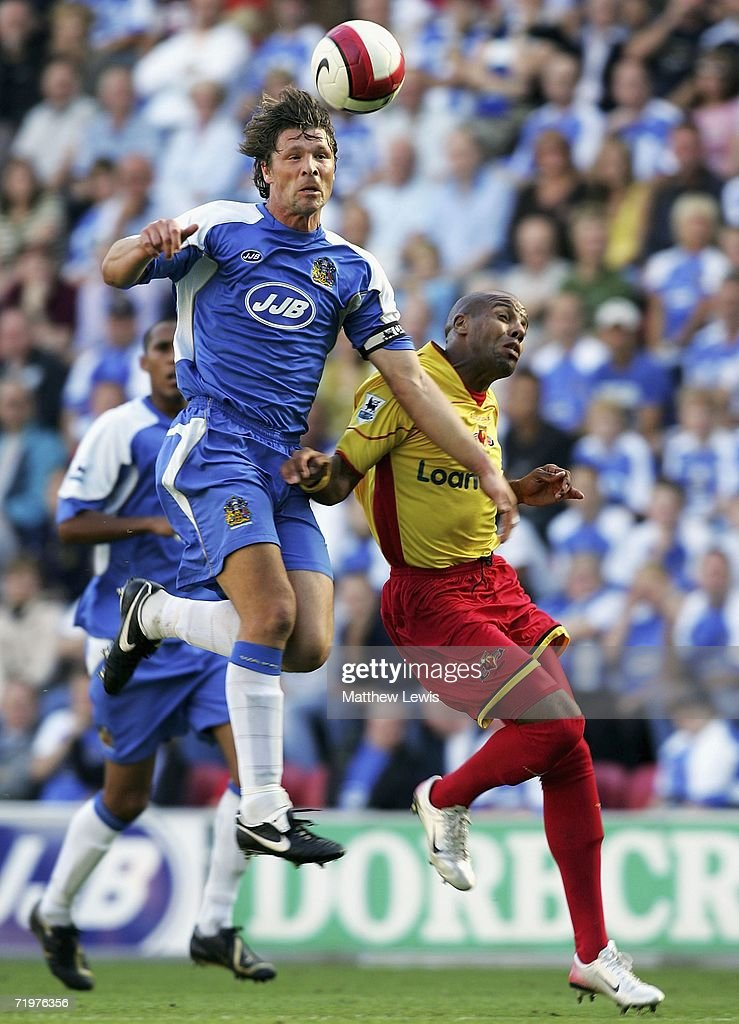 Arjan De Zeeuw of Wigan wins the ball ahead of Marlon King of Watford during the Barclays Premiership match between Wigan Athletic and Watford at the JJB Stadium on September 23, 2006 in Wigan, England.