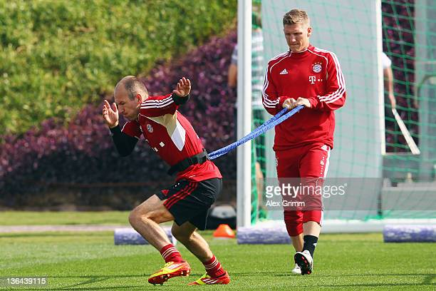 Arjen Robben and Bastian Schweinsteiger exercise during a training session of Bayern Muenchen at the ASPIRE Academy for Sports Excellence on January...