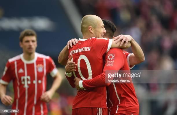 Arjen Robben and Corentin Tolisso of Munich celebrate a goal during the German Bundesliga soccer match between FC Bayern Munich and Hamburger SV at...