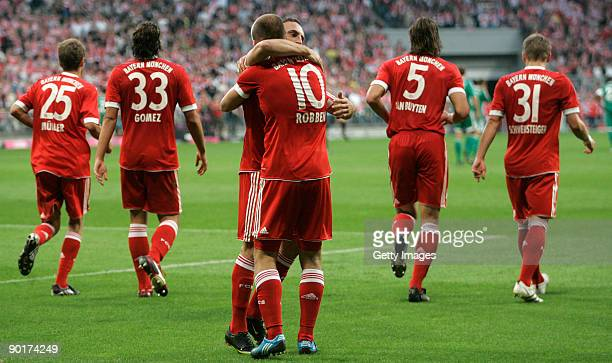 Arjen Robben and Franck Ribery celebrate Robben's goal against Wolfsburg during the Bundesliga match between FC Bayern Muenchen and VfL Wolfsburg at...