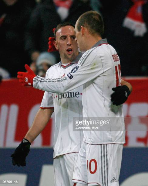 Arjen Robben and Franck Ribery of Bayern Muenchen celebrate Robben's first goal during the UEFA Champions League round of sixteen first leg match...